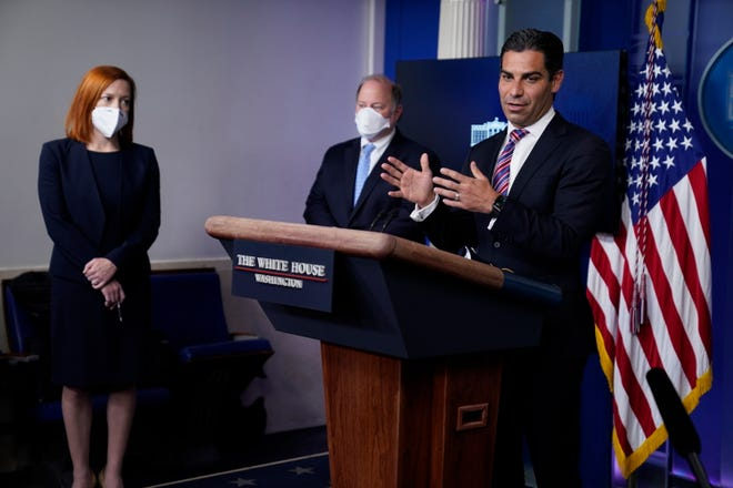 White House press secretary Jen Psaki, left, and Detroit mayor Mike Duggan, center, listen as Miami mayor Francis Suarez speaks during a press briefing at the White House, Friday, Feb. 12, 2021, in Washington.