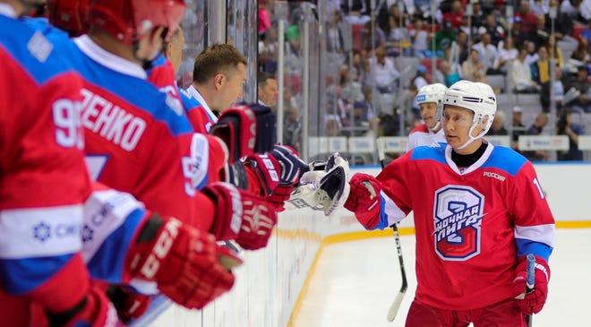 Russian President Vladimir Putin celebrates his goal in Sochi, Russia, in May 2019.