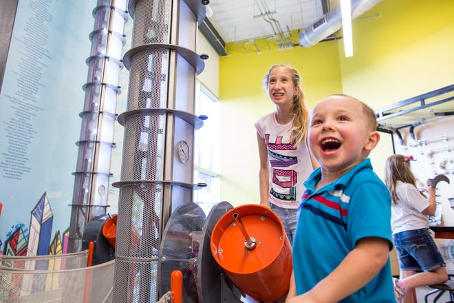 Nicolette Salikhov, 13, and Gage Edwards, 4, use an air gun to launch model planes as they play at the Thinkery in 2017. The museum will run its popular summer camps in-person this year, but with COVID-19 protocols.