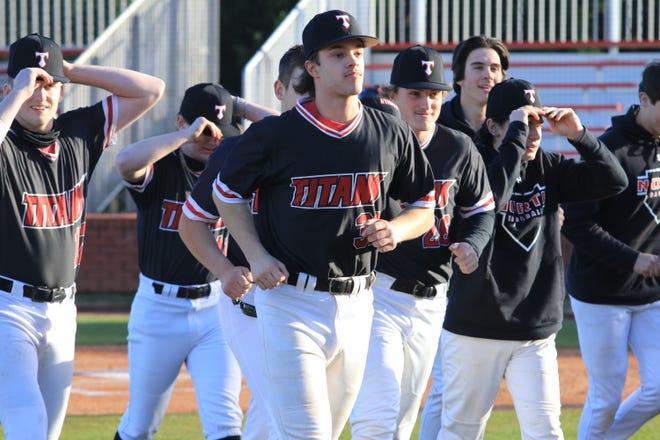 North Oconee baseball players walk toward dugout prior to a game.