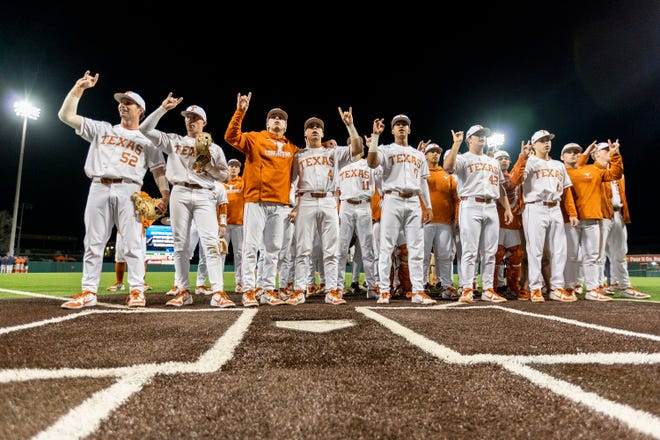 Texas players celebrate last season after beating Cal State Fullerton in Austin. The Longhorns won their 2021 home opener Wednesday 3-1 over BYU.
