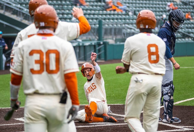 Texas' Douglas Hodo III slides home with a run in the second inning of a 12-6 win over BYU on Thursday.