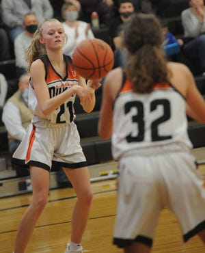 Marlington's Mary Mason passes to teammate Elizabeth Mason in an OHSAA tournament game against West Branch Wednesday, February 24, 2021 at Marlington High School.