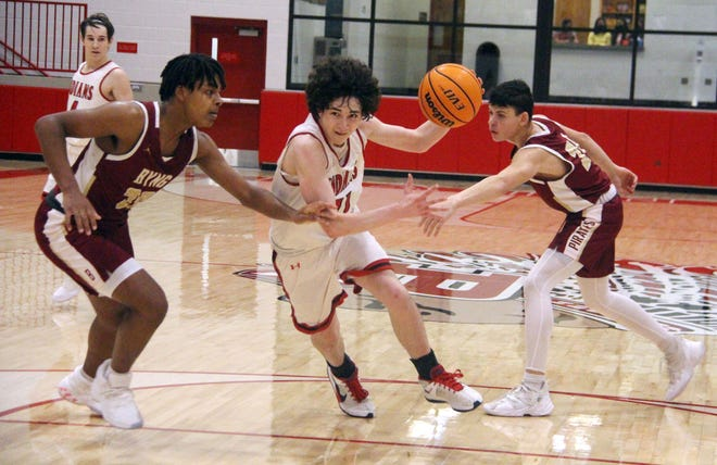 Ethan Barker drives to the basket against a pair of Byng defenders. The freshman scored 13 points to lead the Indians to a 43-40 win over Byng.