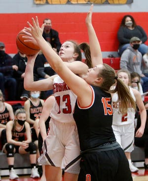 Loudonville's Grace Vermilya (13) puts up a shot against Dalton's Tess Denning (15) during the Redbirds' 78-74 overtime win Wednesday at Loudonville High School. Vermilya scored a school-record 53 points.