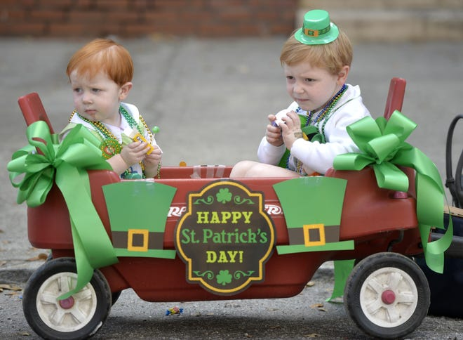 Youngsters Rory Slocum, left, and his brother Garren Slocum, then age 1 and 4, watch the 2017 St. Patrick's Day Parade in downtown Augusta from the comfort of their wagon. No parade is planned for 2021 because of crowd-control concerns related to the COVID-19 pandemic.