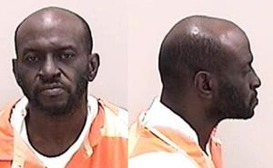 Tyrone Lambert, 47, was charged with murder in the death of Joe Nunnally Jr.