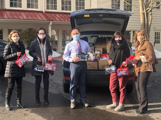 Attorneys and staff from Eastburn and Gray Law firm commemorated the federal holiday of Martin Luther King, Jr. Day with a volunteer project working as a team to assemble 100 personal care kits. The donation was given to the food pantry that serves clients of Family Service Association of Bucks County.