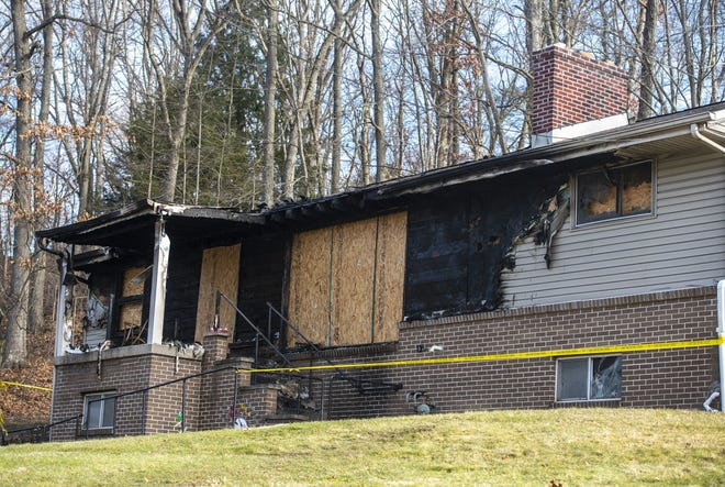 A Center Township woman was killed and her husband injured in a fire Wednesday morning at this Center Grange Road home.