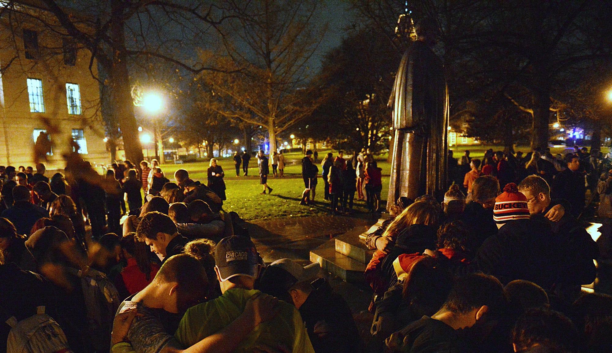 People gather at Ohio State University's Thompson Library to hold a vigil of prayer following death of football senior Kosta Karageorge on Nov. 30, 2014.