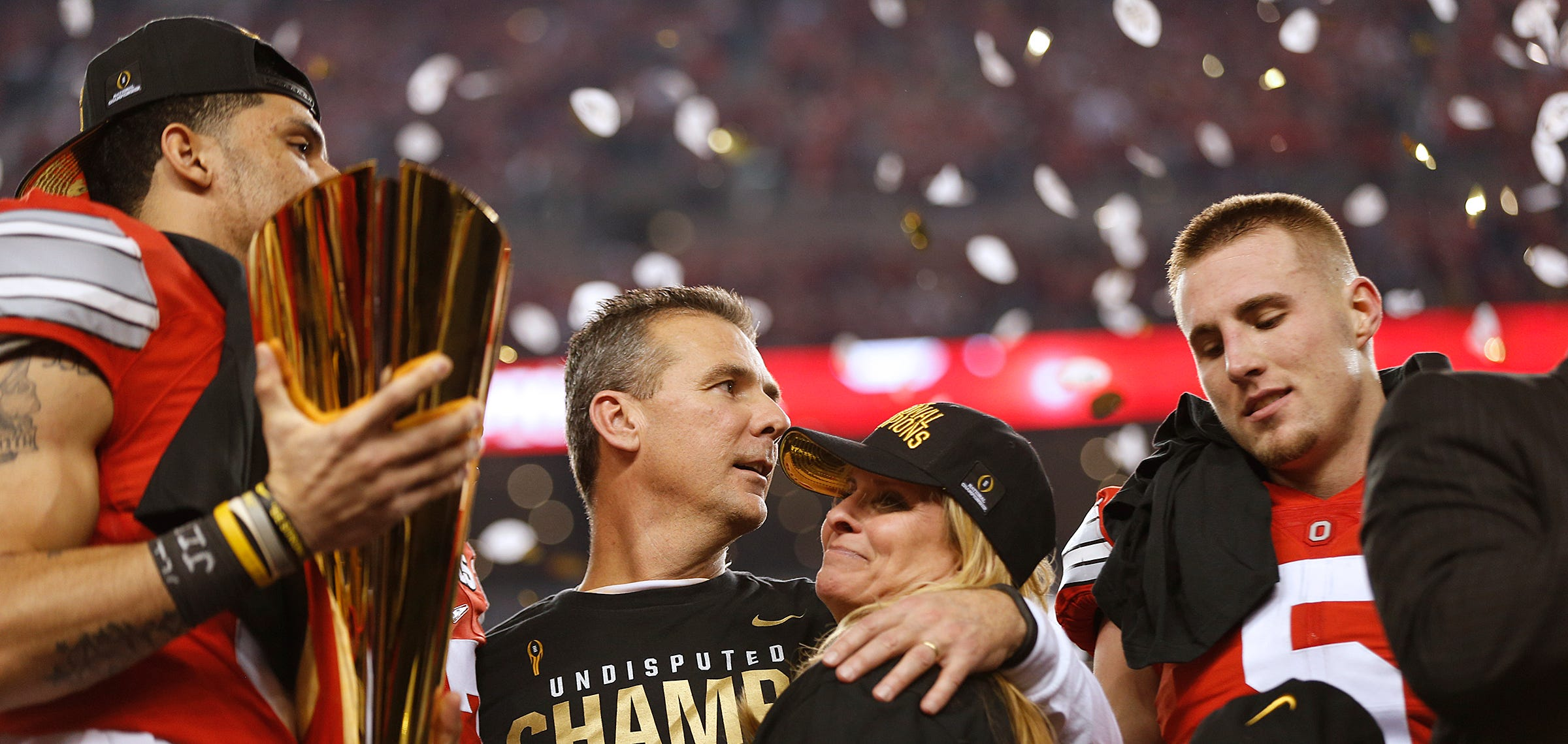Urban Meyer celebrates with his wife Shelley after the College Football Playoff National Championship between the Ohio State Buckeyes and the Oregon Ducks at AT&T Stadium in Arlington, Texas, on Jan. 12, 2015.