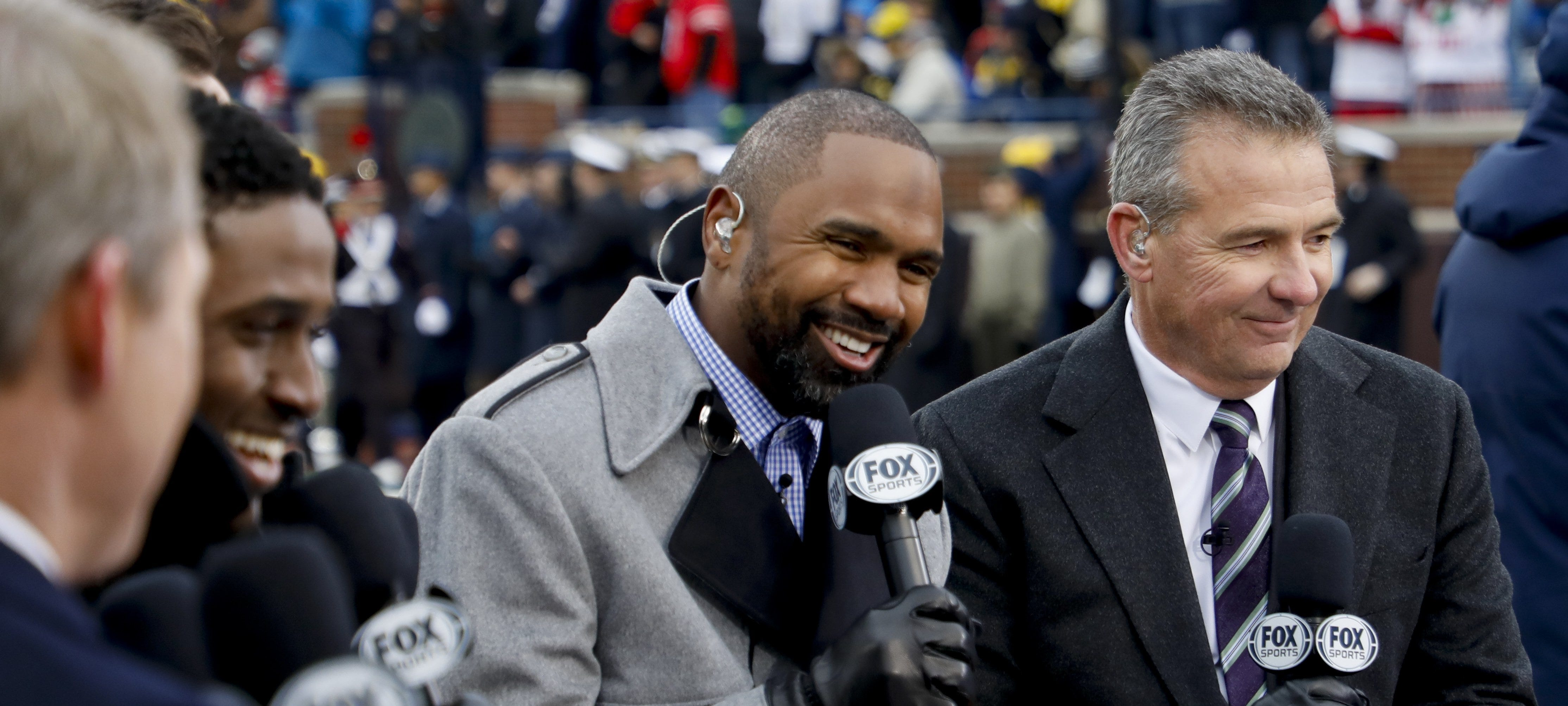 """Charles Woodson, left, and Urban Meyer, right, chat during a broadcast of Fox Sports' """"Big Noon Kickoff"""" before the Michigan and Ohio State game on Nov. 30, 2019 at Michigan Stadium in Ann Arbor, Michigan."""