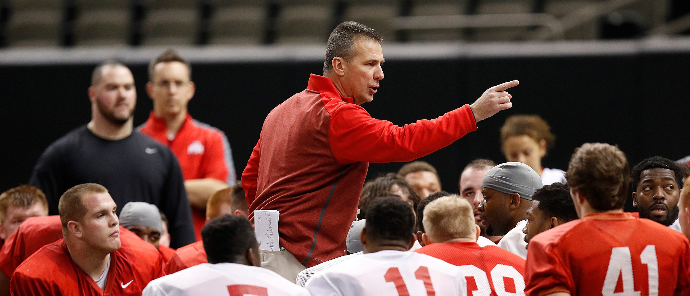 Ohio State Buckeyes coach Urban Meyer talks with his team in a huddle during practice at the Mercedes-Benz Superdome in New Orleans on Dec. 29, 2014.