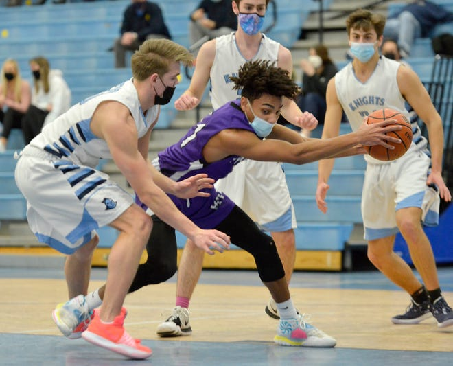 Martha's Vineyard guard Mike Trusty, center, handles the ball during Wednesday's Cape & Islands League Atlantic Tournament boys basketball semifinal at Sandwich. Trusty and the Vineyarders won the tournament championship Friday night against Falmouth.