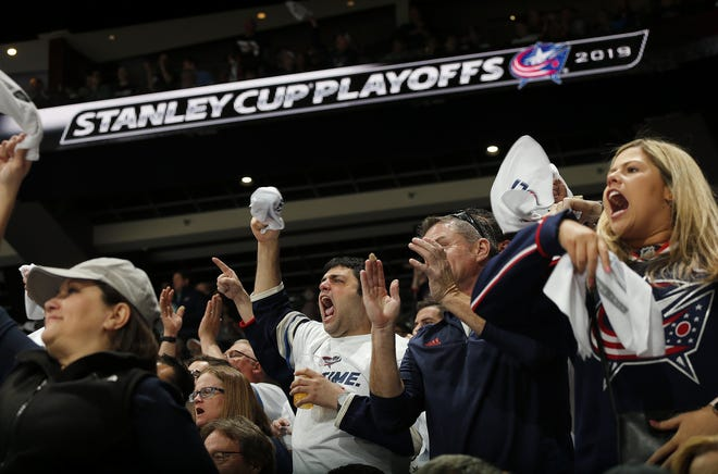 Columbus Blue Jackets fans wave towels and scream loudly during the third period of the NHL Stanley Cup Playoffs Game 4 against the Tampa Bay Lightning at Nationwide Arena in Columbus on Tuesday, April 16, 2019.