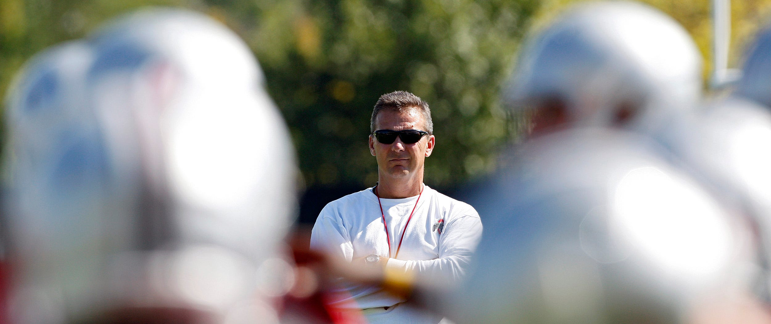 Urban Meyer watches his team warmup before the start of practice at Harmon Family Football Park, August 6, 2012.