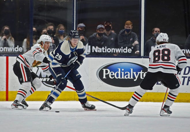 Blackhawks right wing Patrick Kane, here playing against the Blue Jackets' Patrik Laine on Tuesday at Nationwide Arena, has 67 points in 51 games against Columbus, his most against anyteam.