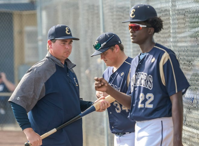 Eustis coach Matt Burgess works with his players before a 2020 game against South Lake at David Lee Diamond-Stuart Cottrell Field in Eustis. [PAUL RYAN / CORRESPONDENT]
