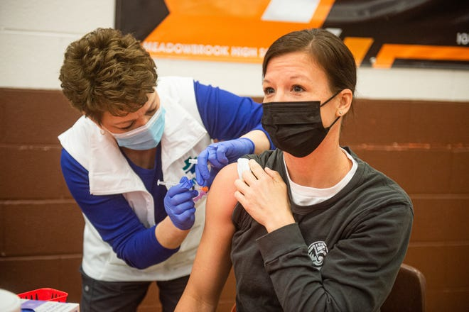 Staff members at school districts in Guernsey County including Rolling Hills received COVID-19 vaccinations from Muskingum Valley Health Center staff members on Thursday.