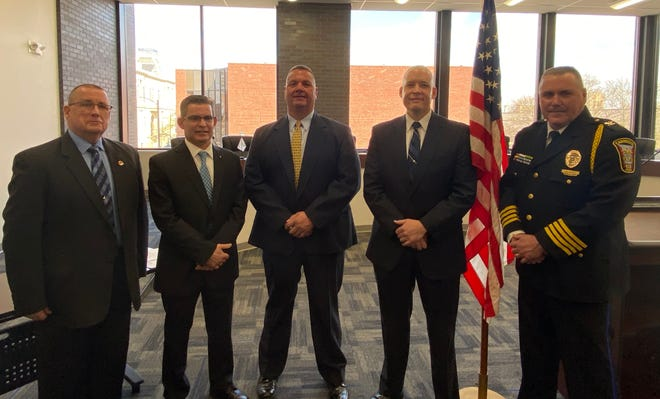 Patrolmen Jason May and Curtis Braniger joined the ranks of the Cambridge Police Department during a swearing-in ceremony Thursday morning. Pictured in City Council chambers are, l to r, Cambridge Safety Director Rocky Hill, Mayor Tom Orr, May, Braniger and Police Chief Mark DeLancey.