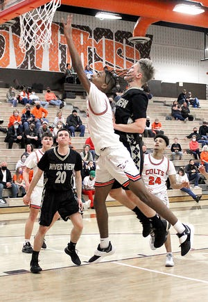 Meadowbrook senior Johna McCall (2) goes up for two of his total 13 points during Wednesday's Division II sectional first round 68-54 win over River View  at Meadowbrook High School.