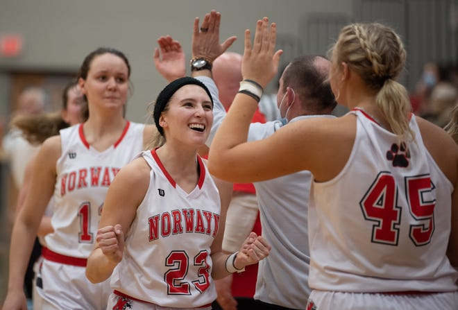 Caitlyn DeMassimo celebrates Norwayne's district semifinal win over Chippewa. DeMassimo had 15 points and five steals, despite having to sit for much of the second half due to foul trouble.