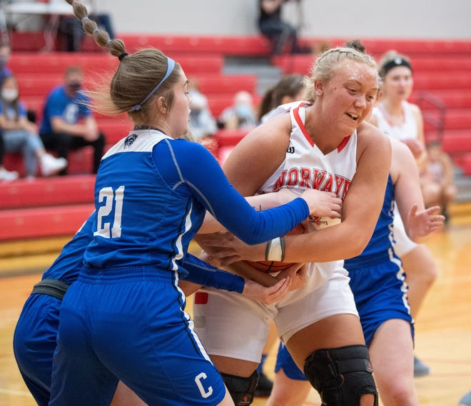 Norwayne's Kennedy Kay battles for possession with Annabel Rodriguez (left).