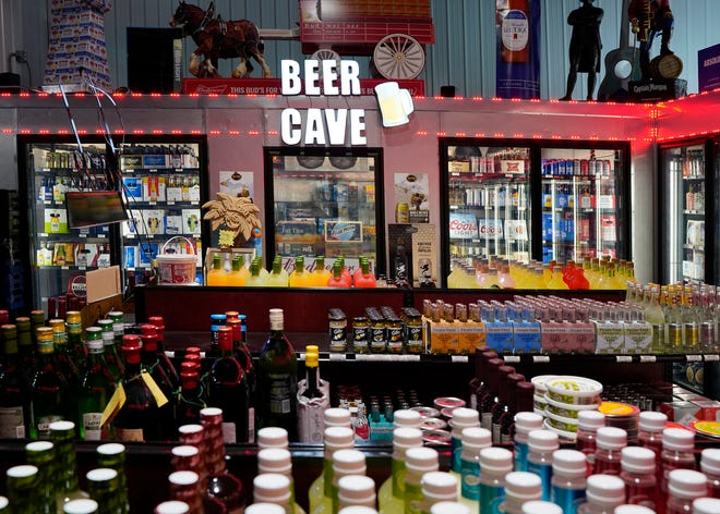 One of two beer caves inside Fine Time Beverage, 1145 N. Main St., Adrian, is pictured Thursday. The liquor store opened last year and sports a wide variety of beer, liquor and wine.
