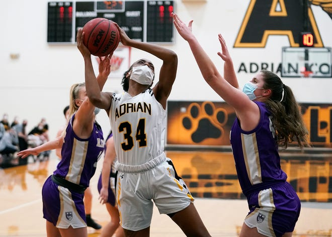 Adrian College's Sha'Trice Graves goes up for a shot during Wednesday's game against Albion.