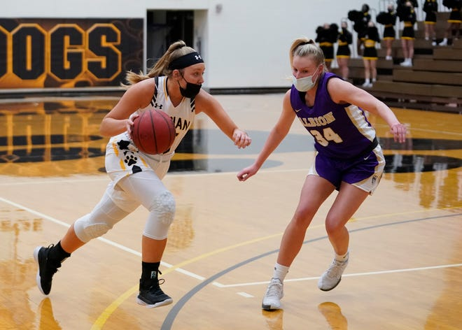 Adrian College senior guard Rachel Bucher (15) drives against Albion College junior Beth Chick during the first half of Wednesday night's MIAA contest at the Merillat Sport and Fitness Center.