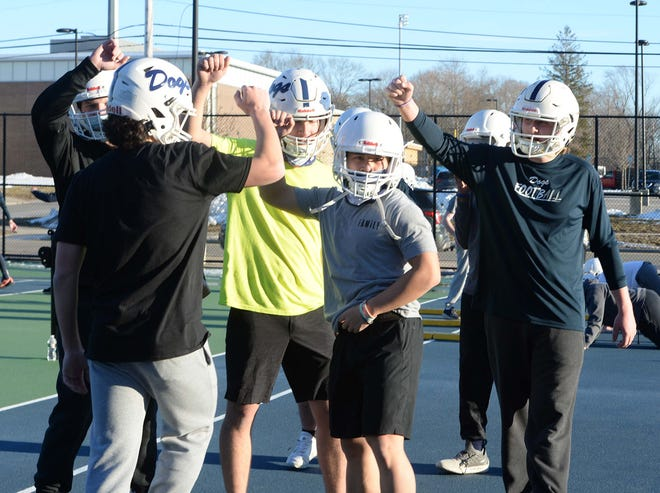 Co-captain Joey Nguyen,  center,  during Rockland High School football practice on Wednesday, Feb. 24, 2021.