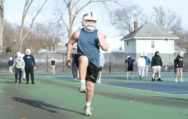 Co-captain Nick Leander, running during Rockland High School football practice on Wednesday, Feb. 24, 2021.