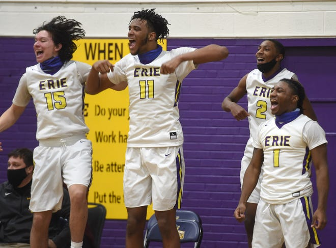 From left, Stephen Scheppner, Marquell Darnell, Marcell Banks and John Woodward of the Erie High boys basketball team cheer for their teammates in the final seconds of a win over Meadville on Feb. 24 at Erie High School. The Royals face Upper St. Clair in a PIAA Class 6A boys basketball quarterfinal on Saturday.