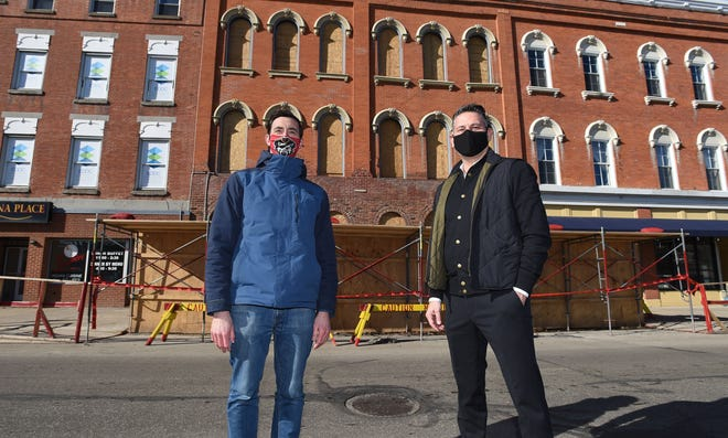 John Persinger, left, CEO of the Erie Downtown Development Corp and Chris Potter, right, an Erie native turned New York restaurant co-owner are shown Thursday outside the new Flagship City Food Hall on North Park Row. Potter plans to open Noodlelove, a restaurant in the new food hall.
