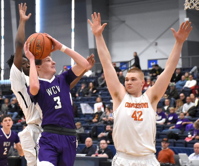 Andrew Soron goes up for a shot for West Canada Valley against Cooperstown's John Kennedy (42) at SRC Arena in Syracuse. The Feb. 29, 2020, Section III semifinals were the last basketball games played by Herkimer County high schools.