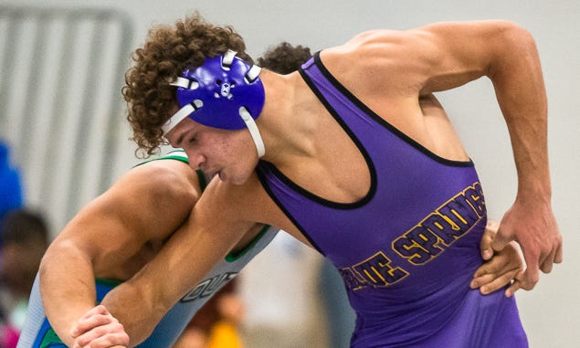 Jaxson McIntyre, front, is one of five district champions Blue Springs will enter into Saturday's Class 4 Sectional 4 tournament Saturday at Staley High School. Wrestlers will need a top three finish in the new sectional round to advance to state.