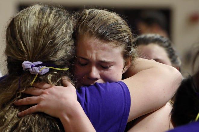 Notre Dame High School's Megan Harrell (5) hugs a teammate following their 65-57 loss of their Class 1A regional final against Springville, Wednesday Feb. 24, 2021 at Muscatine High School.