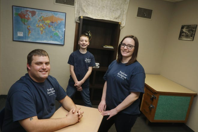 Joe Shaffer, wife Michelle Castle and her son, Breyen Duffie, 13, are shown Tuesday inside the Pop Quiz escape room at Breakout Burlington, 1100 East Agency St. Breakout Burlington features two escape rooms suitable for families, couples or small groups. Participants will solve puzzles, crack codes and find hidden items to exit the room. The goal is to solve the puzzle within one hour.