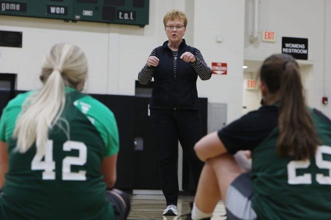 Sue Hockett-Schowalter a member of the 1976 West Burlington High School basketball team, the school's first team to qualify for the state tournament talks to current players about her tournament experiences and offers some advice to the current members of the team during a practice session, Wednesday Feb. 24, 2021 in the school's gymnasium. The Falcons will face fourth-ranked West Lyon at 7 p.m. March 1 in the first round of the state tournament at Wells Fargo Arena in Des Moines.