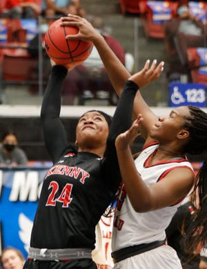 Bishop Kenny's Jasmyne Roberts (24) has a shot blocked from behind by Lake Highland Prep defender Kayla Blackshear (23) in the FHSAA Girls State Semi-Final Basketball game at the RP Funding Center in Lakeland Fl. February 25th 2021.  [Calvin Knight/Special to the Ledger]