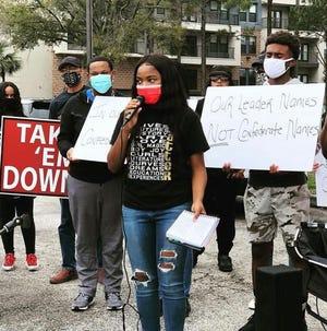 Deyona Burton speaks at a rally