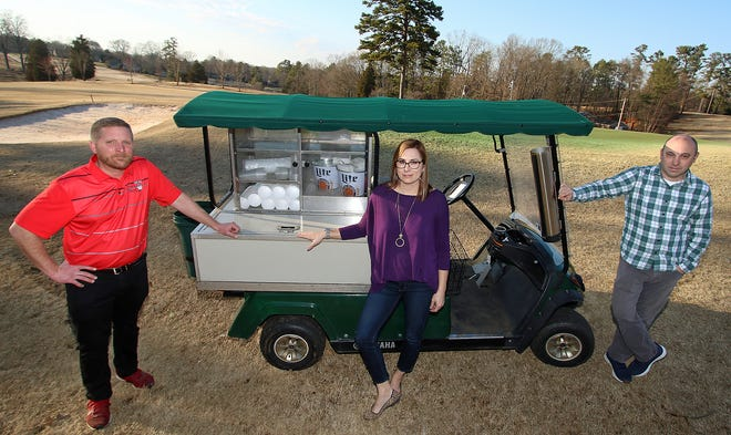 Jack Acheson, Laura Arrowood and Trey Daughtridge pose next to the beer cart as Kings Mountain Country Club is set to open a new restaurant to the public in early March, The Crow's Nest.