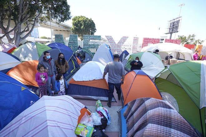 Asylum seekers have set up tents as they settle in at El Chaparral port of entry on Wednesday, Feb. 24, 2021, in Tijuana, Baja California. Hundreds wait in the area.