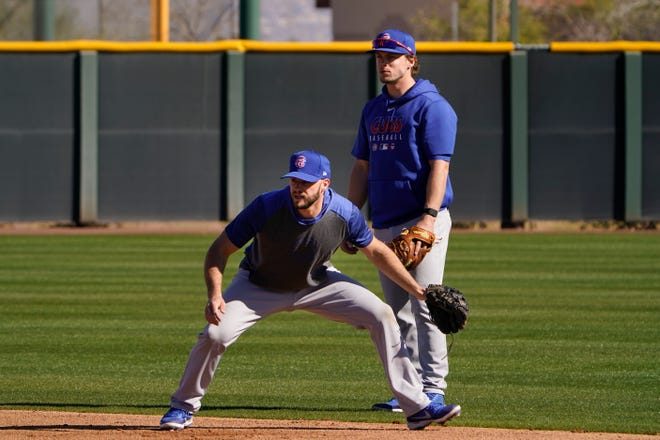 Chicago Cubs' David Bote, left, and Nico Hoerner train during the team's spring training baseball workout in Mesa, Ariz. on Monday.