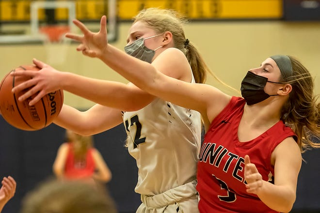 Knoxville's Kaci Luptak, left, battles United's Madison Penn for a rebound during the Blue Bullets' 53-26 win over the Red Storm on Wednesday night in Knoxville.