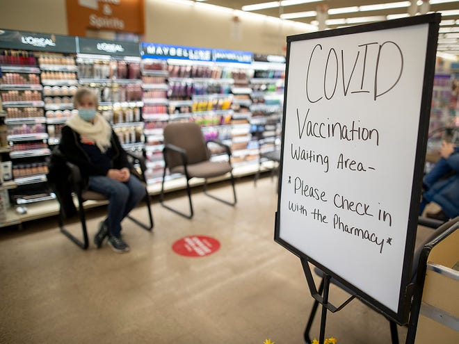Penny Flesner of Knoxville awaits her COVID-19 vaccination in a special seating area of the pharmacy at Hy-Vee, 2030 E. Main St., on Thursday, Feb. 25, 2021.