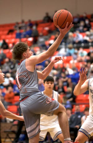 Glen Rose's Kolton Mooney drives to the basket for two of his nine points on Wednesday night.