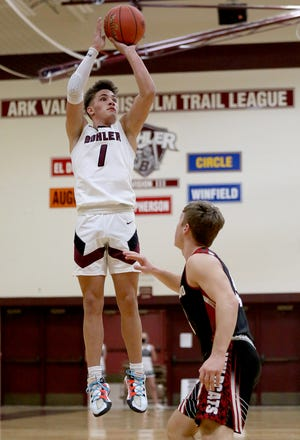 Buhler's Max Alexander (1) shoots the ball past El Dorado's Jayden Sundgren (3) during their game Tuesday night. Buhler defeated El Dorado 73-57. Alexander was the team's high scorer with 36 points in the game.