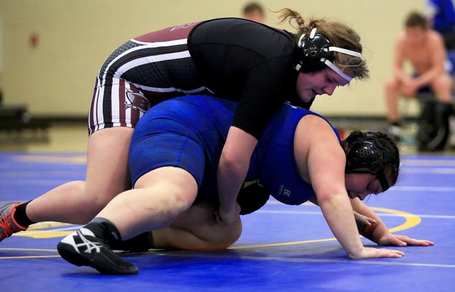 Buhler's Emilie Schweizer wrestles Nickerson's Maddi Miller in the 191-pound weight class during the girls wrestling portion of the Reno County Classic Triangular on Tuesday evening at Hutchinson High School. Both wrestlers are competing Friday in the Class 4A state wrestling tournament.