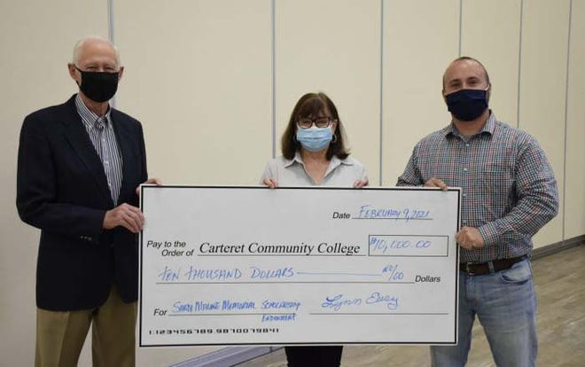 During the February Carteret Community College Board of Trustees meeting, Lynn Eury presented the board with a $10,000 check establishing the Sandi Malone Memorial Scholarship Endowment. The scholarship is in memory of Sandi Malone for her positive impacts on Carteret County. The scholarship will benefit Carteret CC students in the Horticulture Technology program who maintain a 3.0 GPA and reside in Carteret County. Donations to the Sandi Malone Memorial Scholarship can be made through the Carteret CC Foundation by mail, online at www.carteret.edu/foundation, or by calling (252) 222-6262.